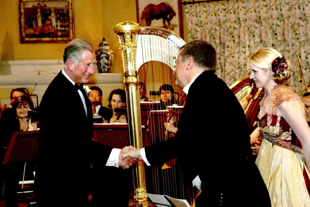 HRH The Prince of Wales congratulating Patrick after the premiere of the Highgrove Suite